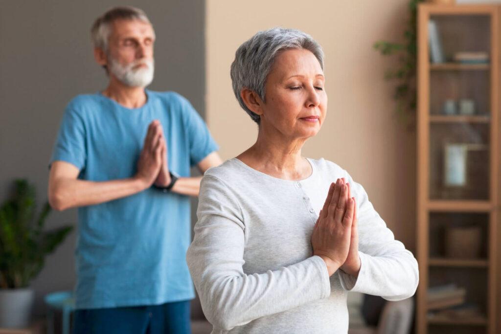 active-senior-people-doing-yoga-home