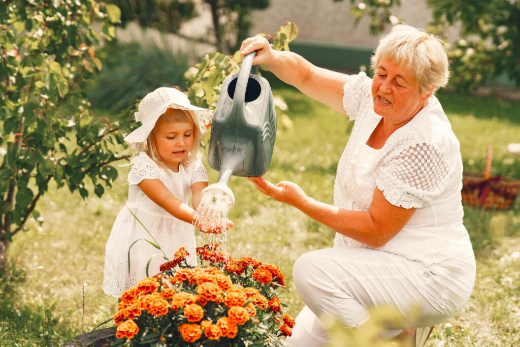 small-girl-with-senior-grandmother-gardening